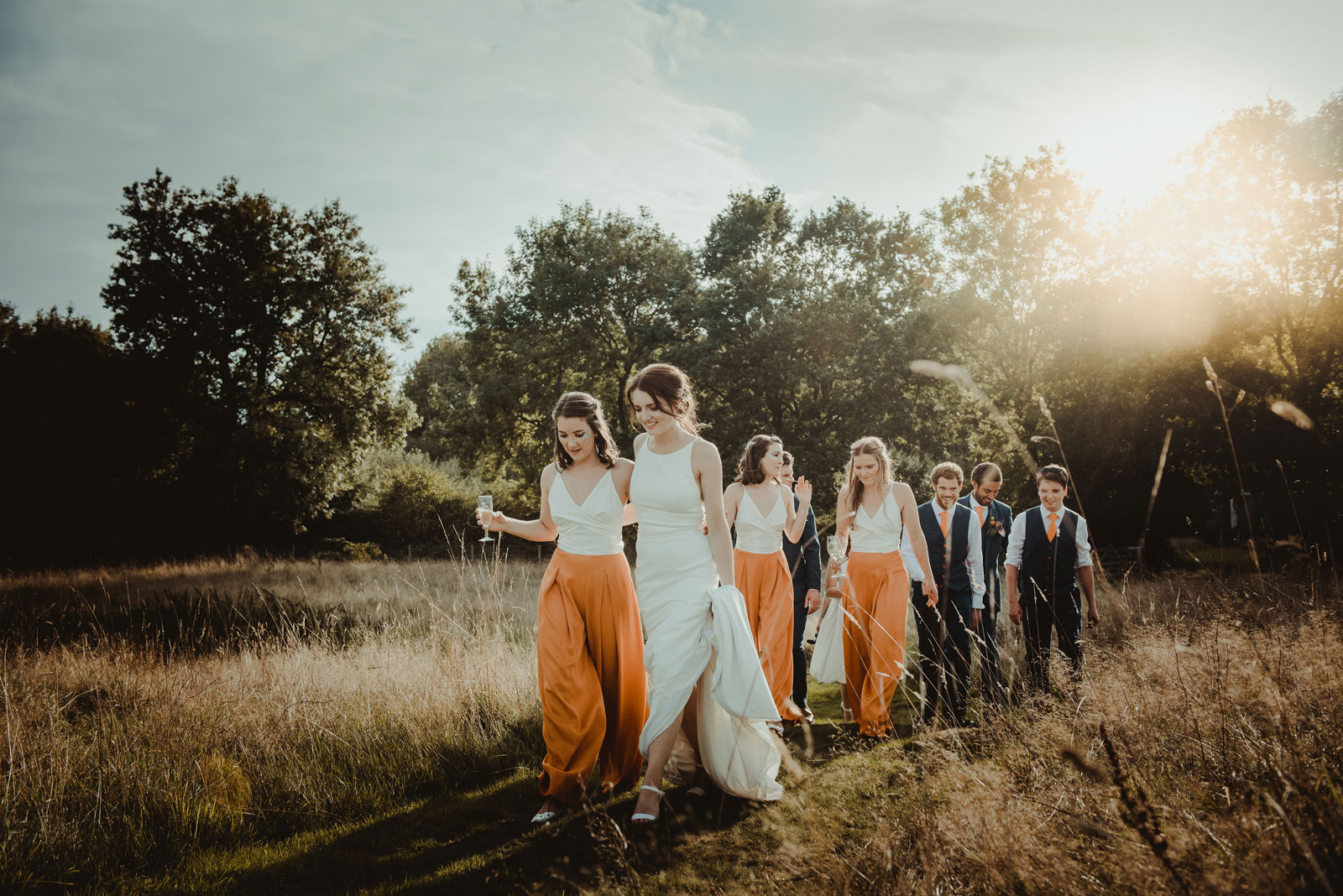 Bride with her bridal party walking at church farm langley langley