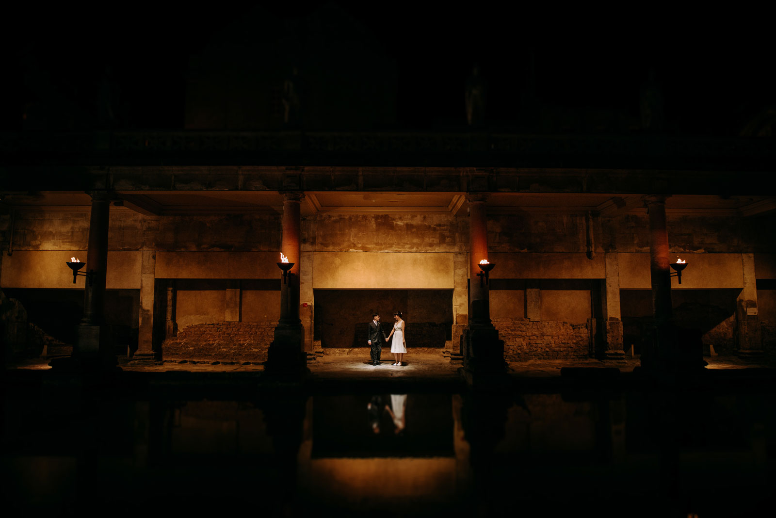 Chloe & Lawrence at the Roman Bath in Bath Somerset for thier sunset wedding