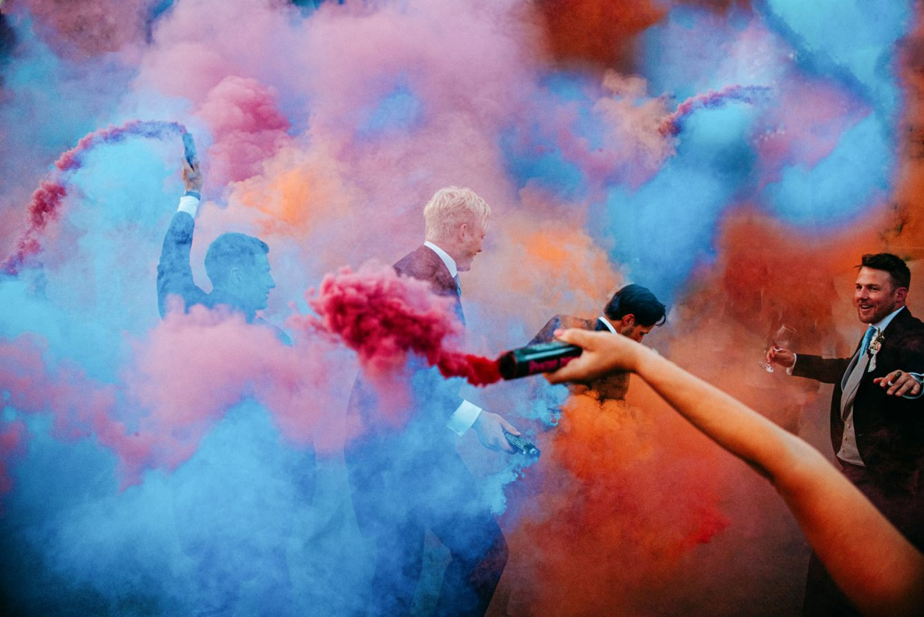 W wedding with smoke bombs at syrencot in wiltshire