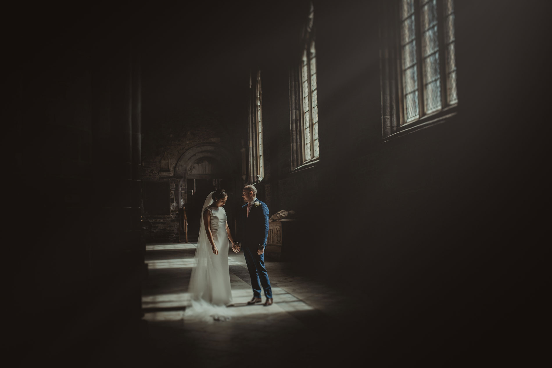 bride and groom at st davids cathedral with window light