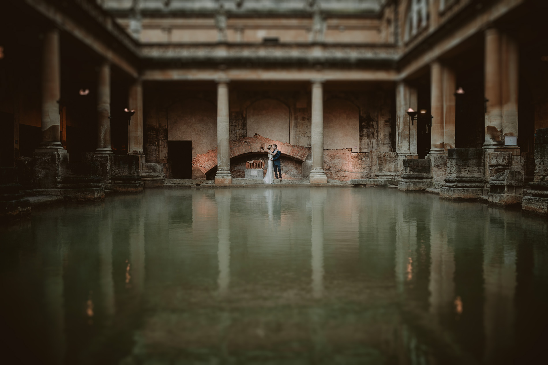 Bride and groom at The Roma Baths in Bath. Andrew Brannan Photography