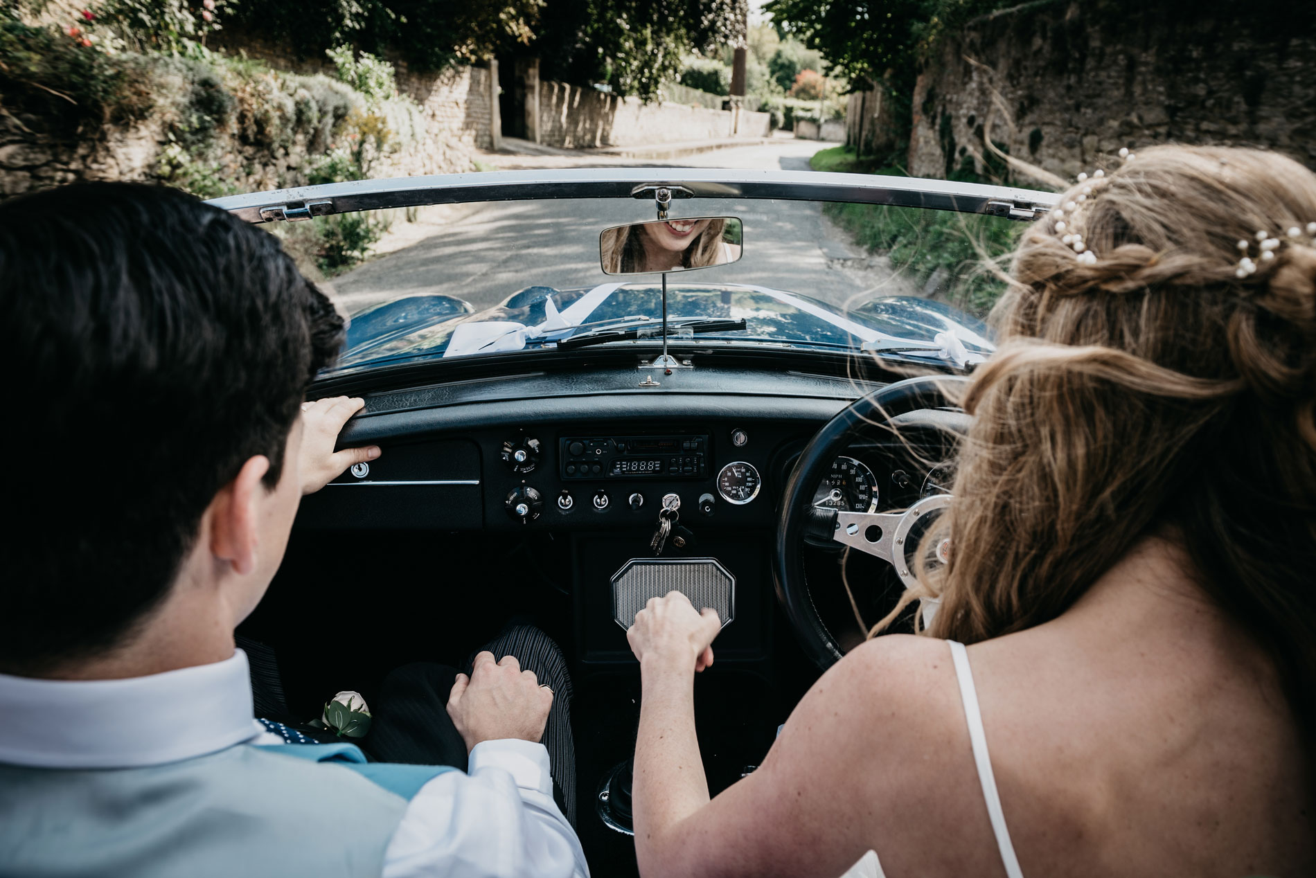 peter and rebecca driving their fast vintage MG car around Oxfordshire