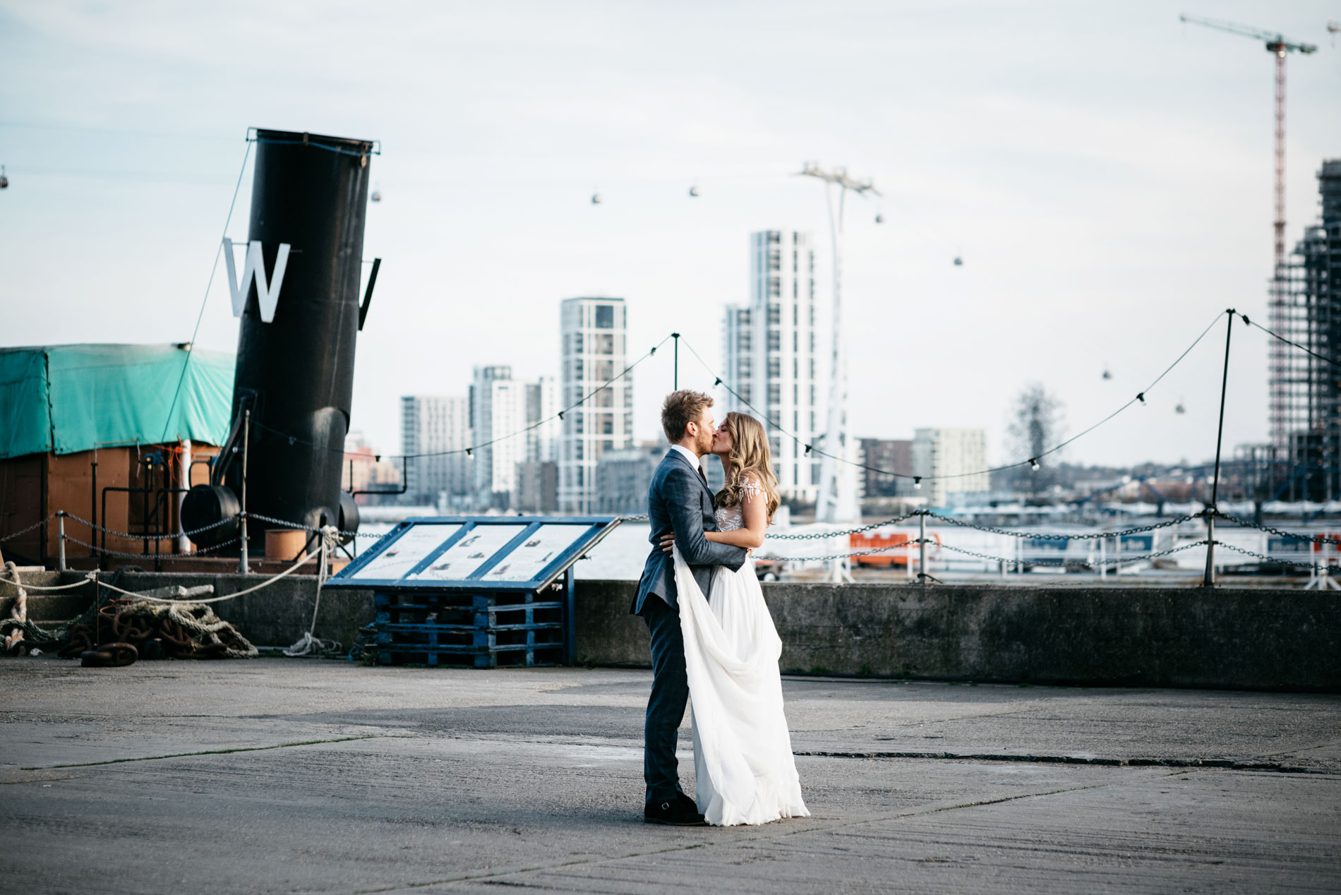 Sam and Lauren kissing at trinity Wharf london