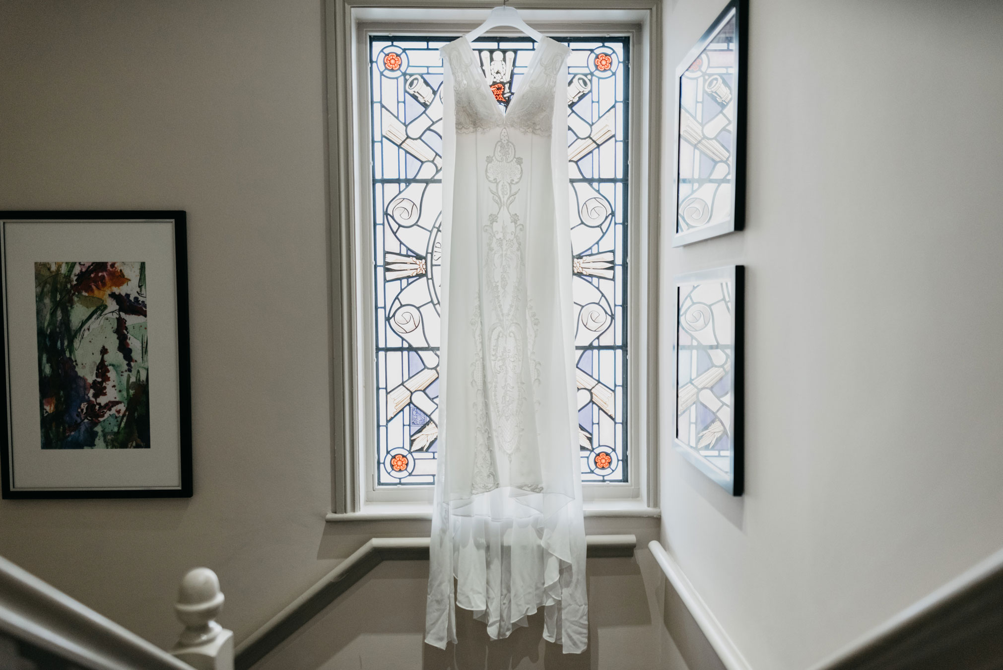brides dress hung up at the window