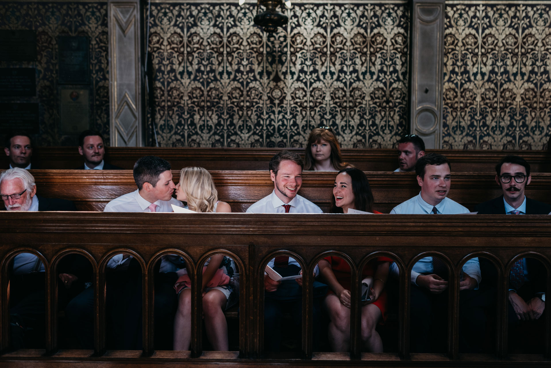 wedding guest sitting in the pews