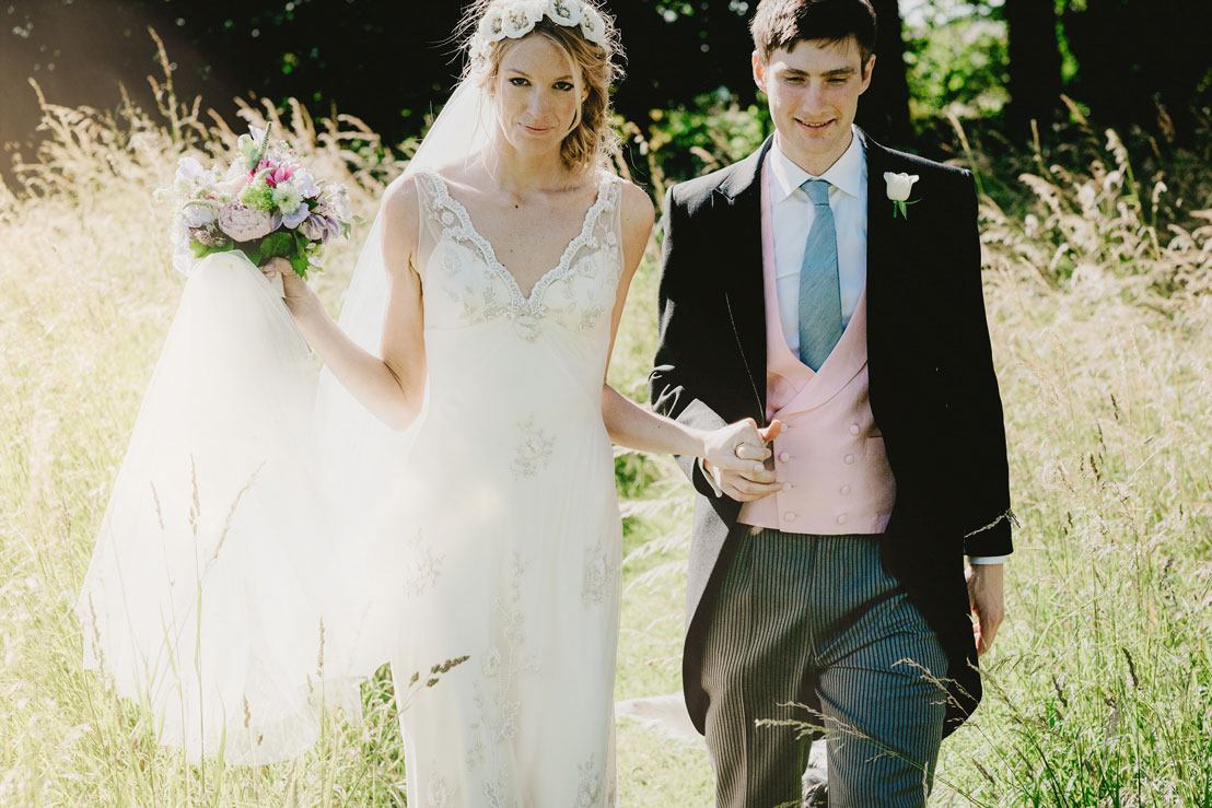 bride and groom walking in their garden at-home-in-Warminster