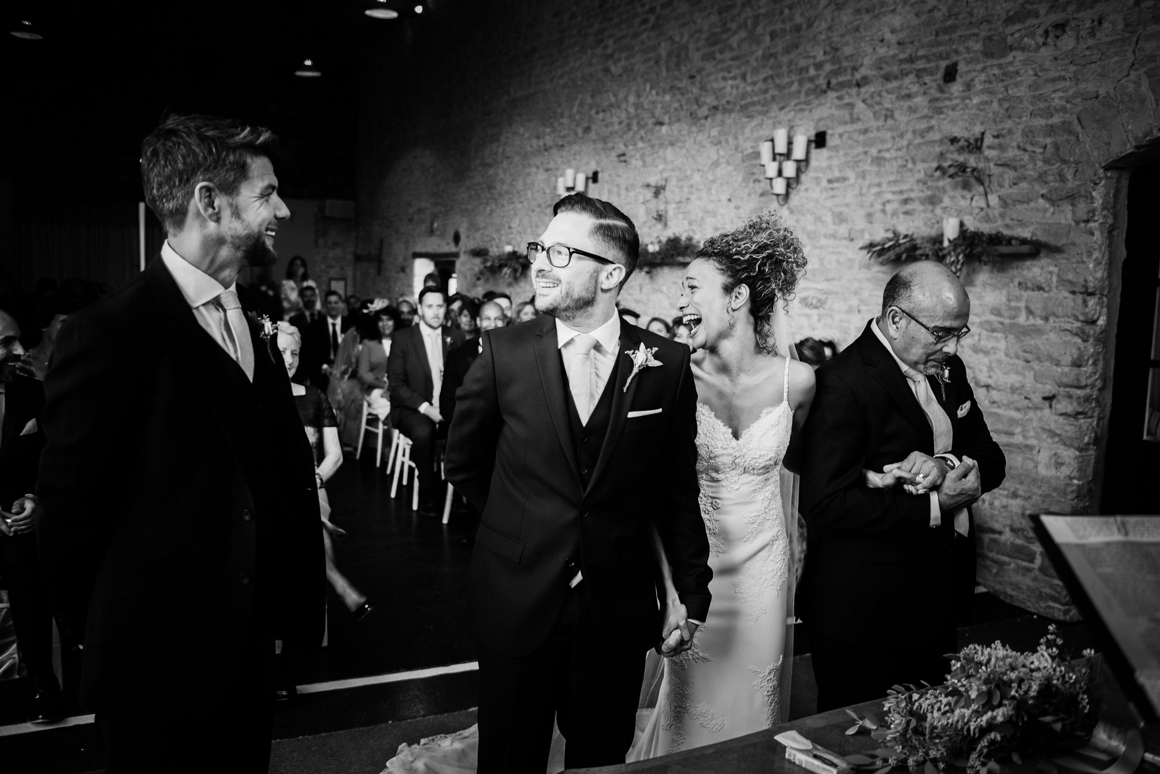 bride laughing with guests at merriscourt barn
