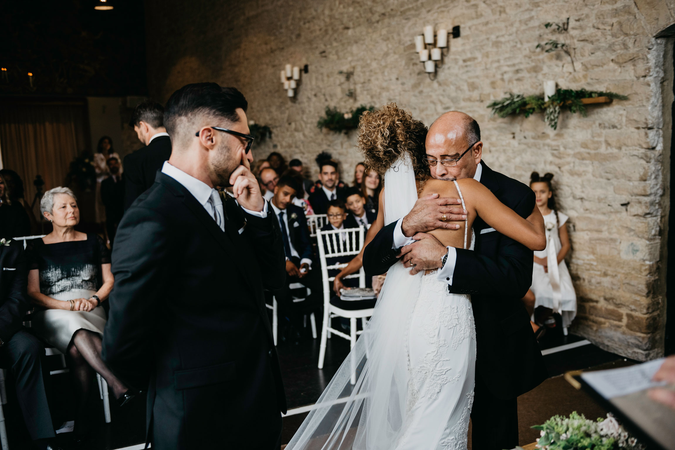 bride and father hug as he gives her away