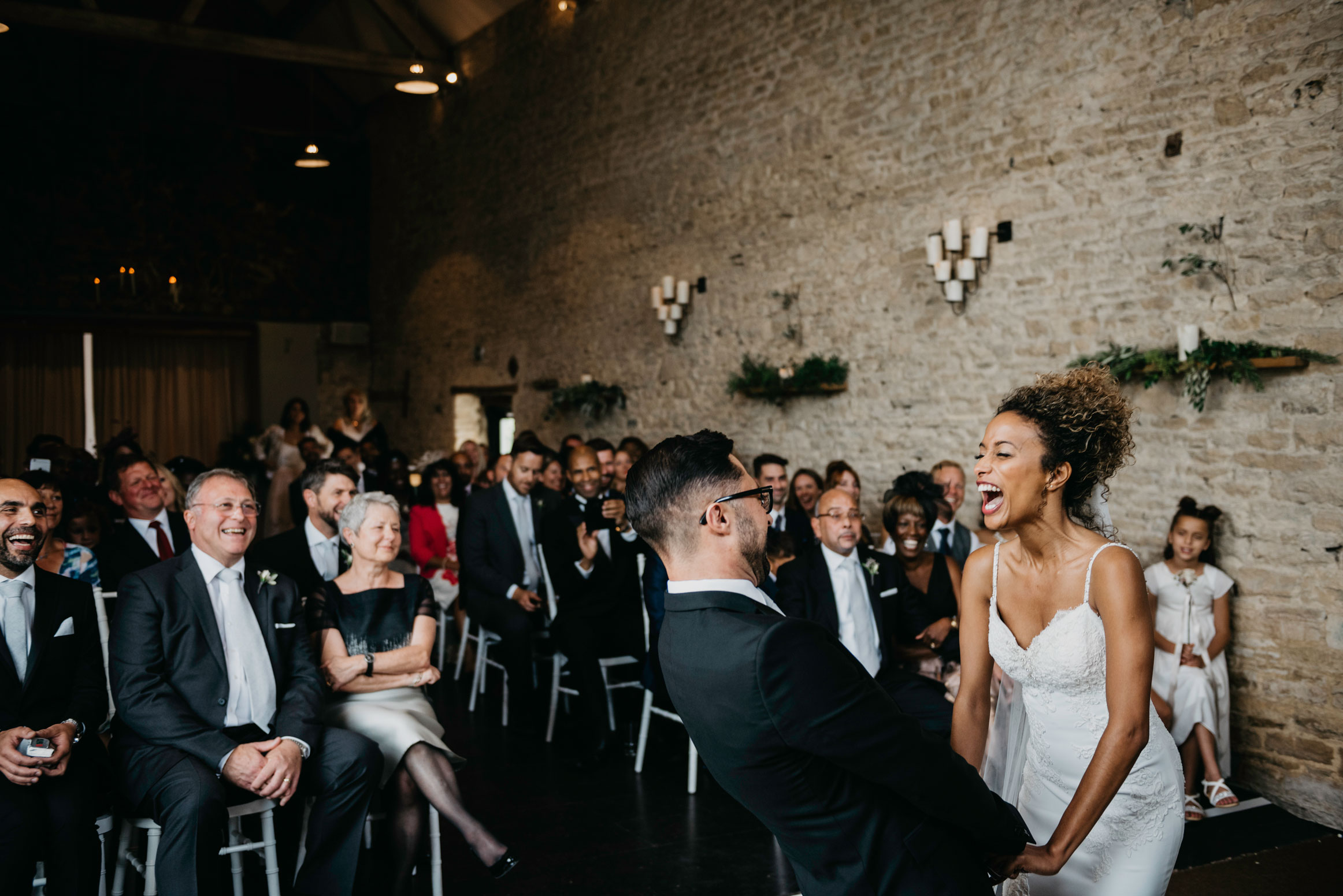 bride and groom laugh hysterically at merriscourt barn