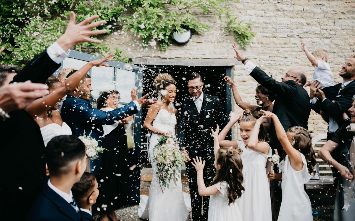 bride and groom and lots of confetti