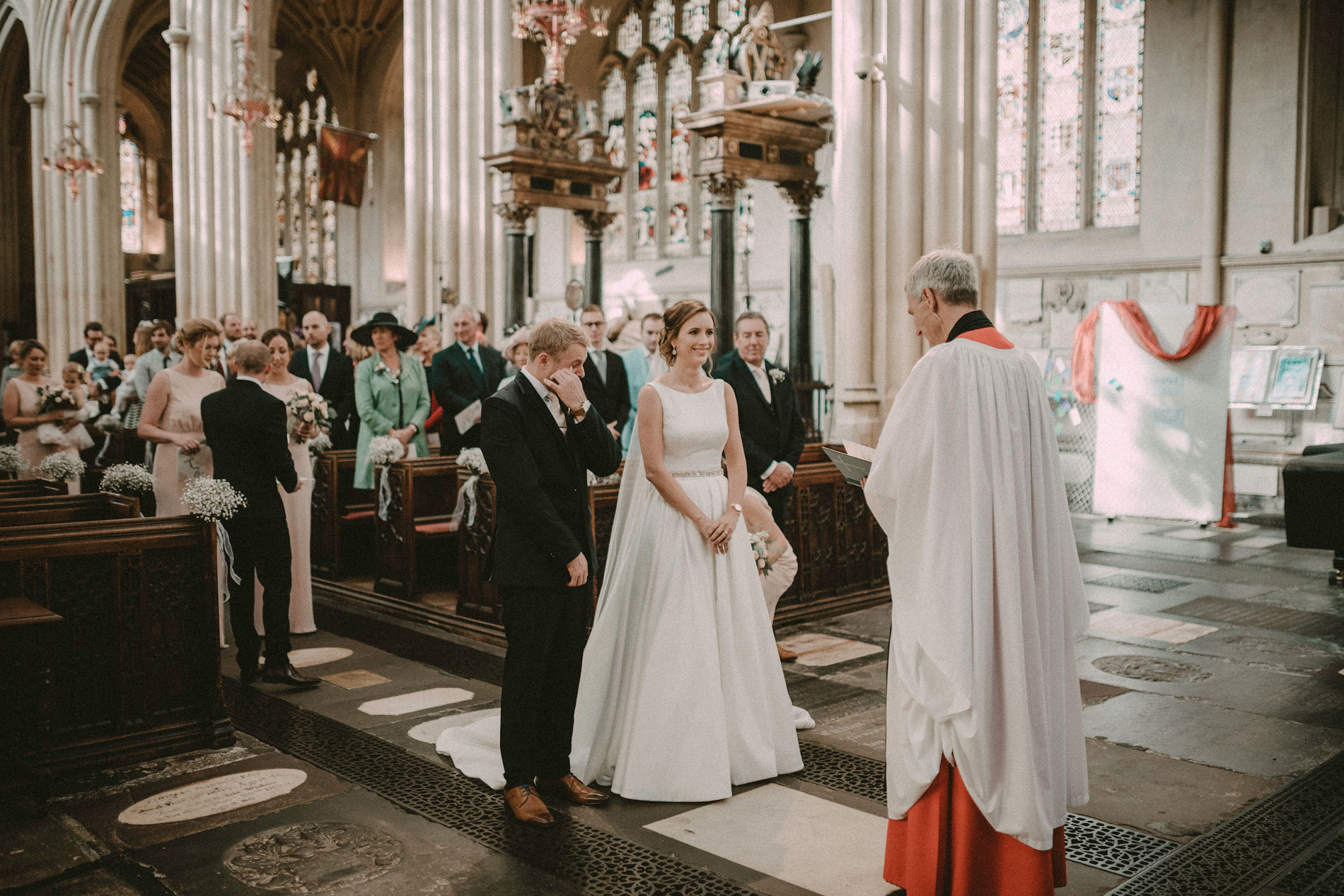 an emotional groom crying at Bath Abbey