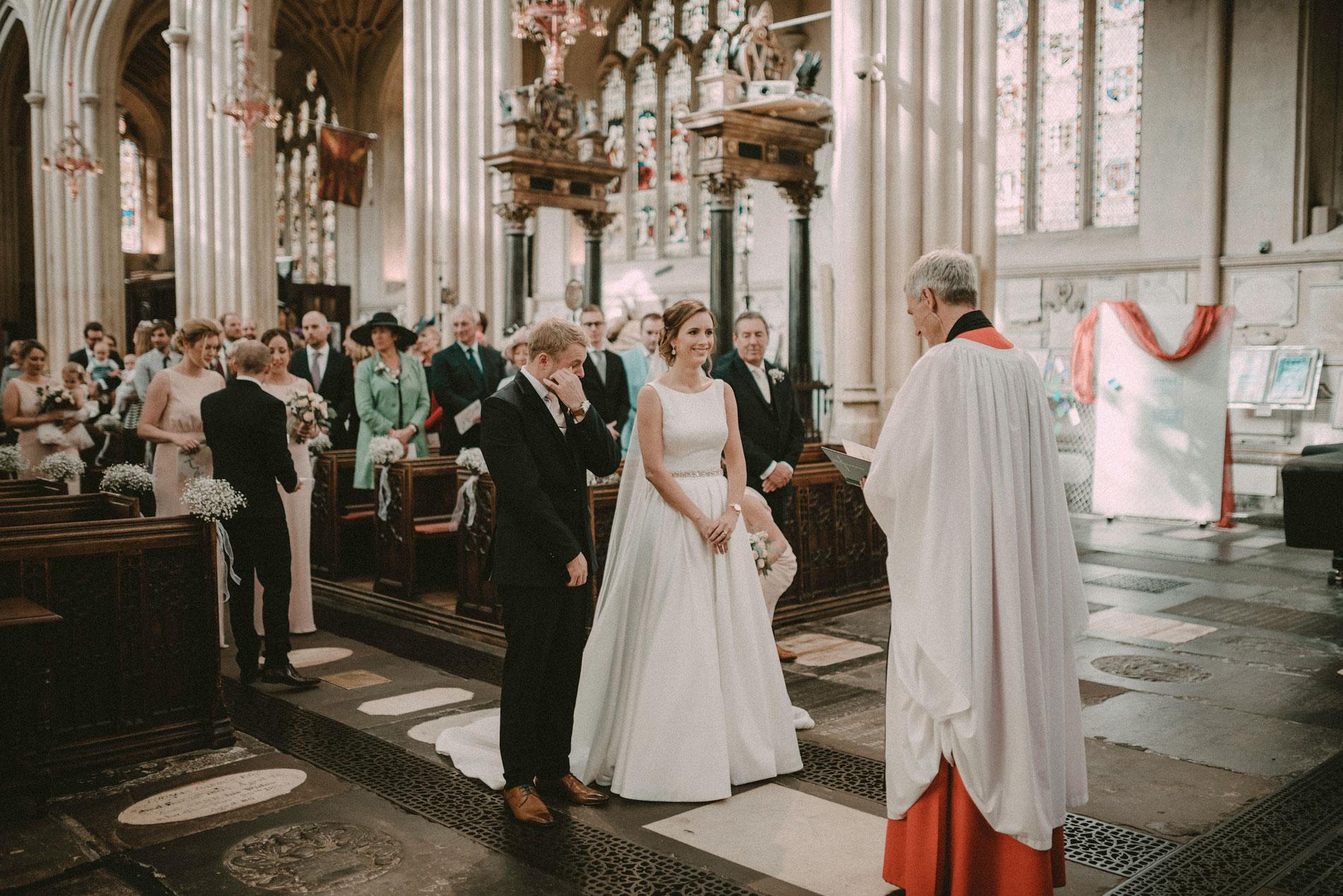 an emotional groom crying at Bath Abbey