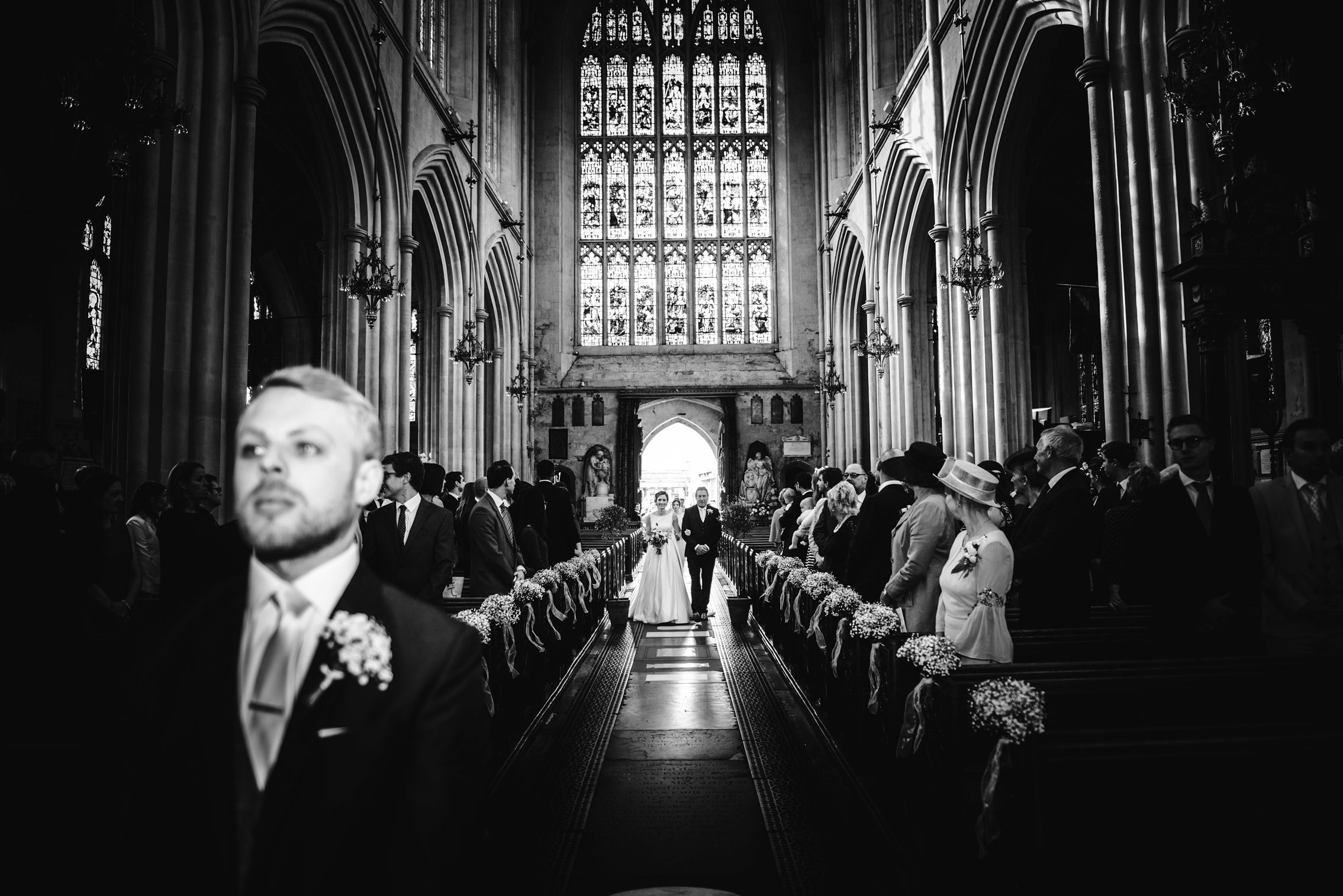 bride and father walking down the aisle at Bath Abbey