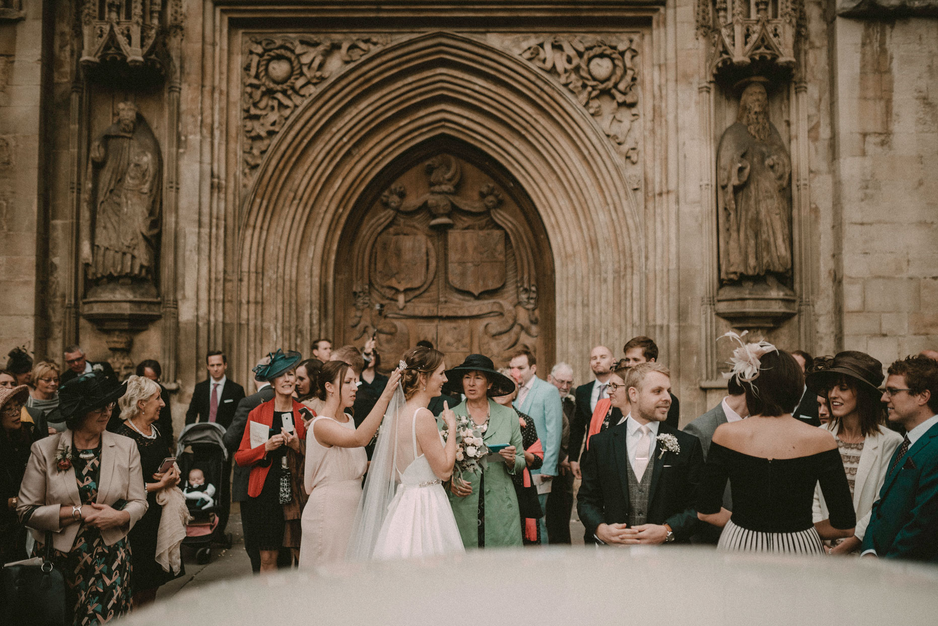 bride and guest outside Bath Abbey