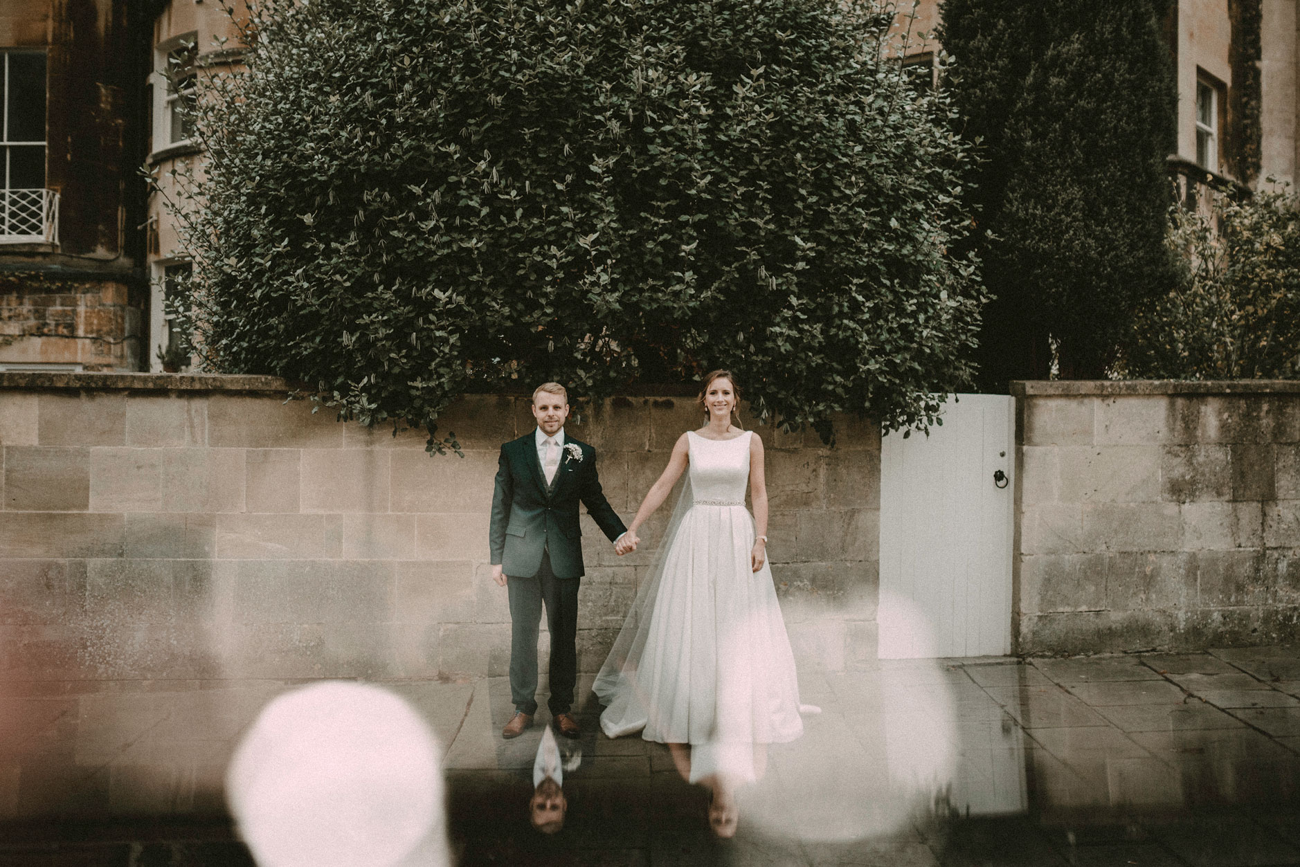 Bride and groom outside The Assembly Rooms in Bath