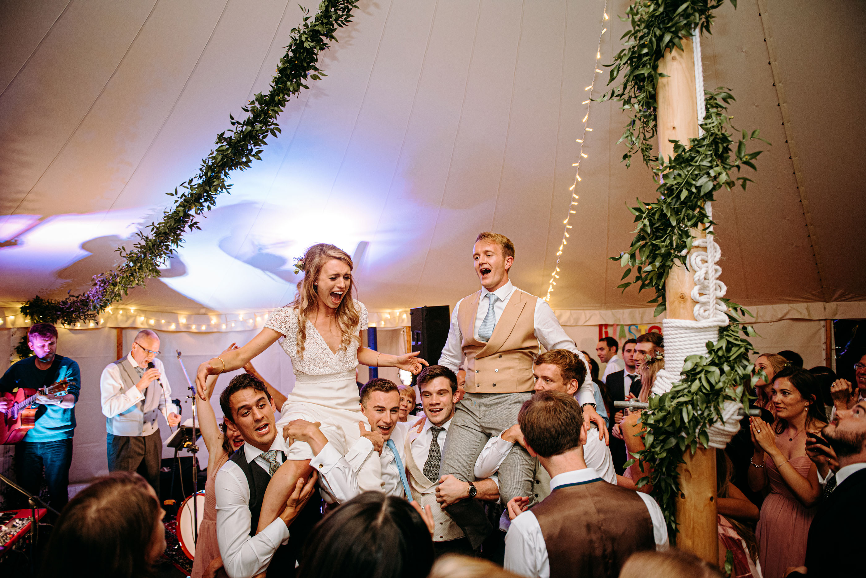 danny and Sarah dancing on the shoulders of their guest at Prior Park Bath Somerset