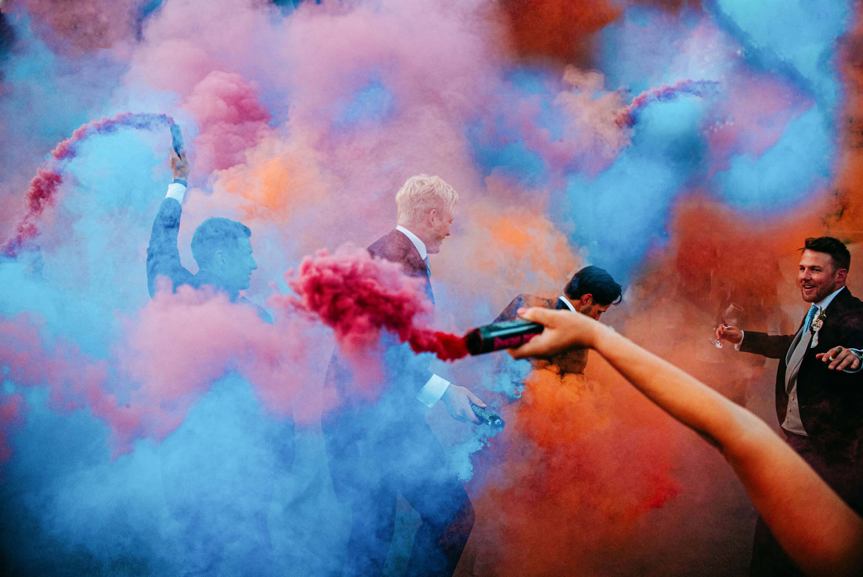 Smoke bombs at wedding at syrencot barn wiltshire