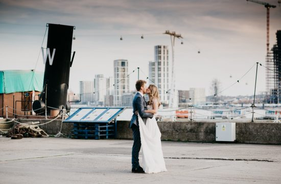 bride and groom kissing on the pier at Trinity Buoy Wharf