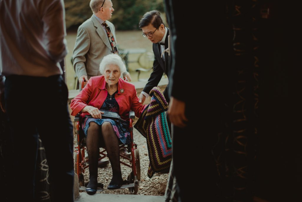 Grooms grandmother arrives at the ceremony ay homewood park in Bath