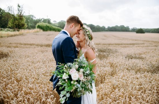 Katie and marks portriat in the hay field in canterbury kent