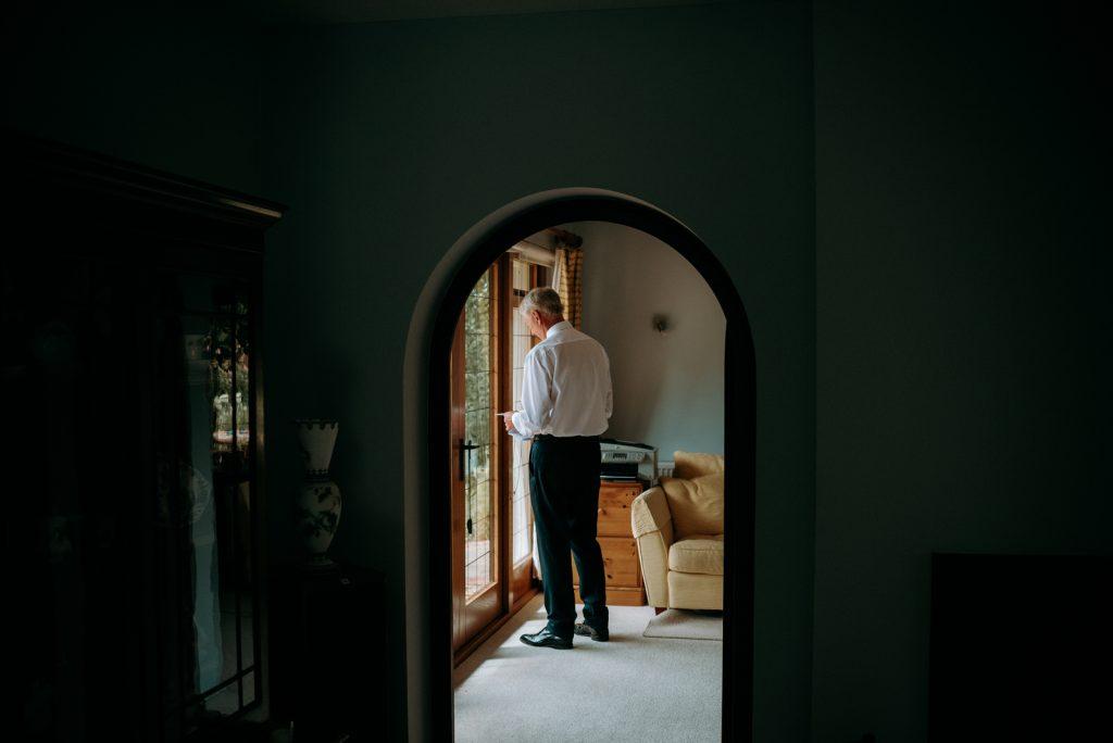 kates father going through his peech at home