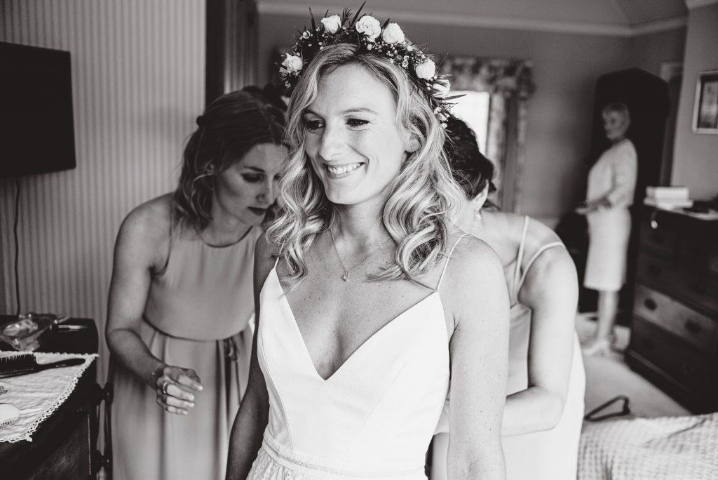 katies putting on her wedding dress