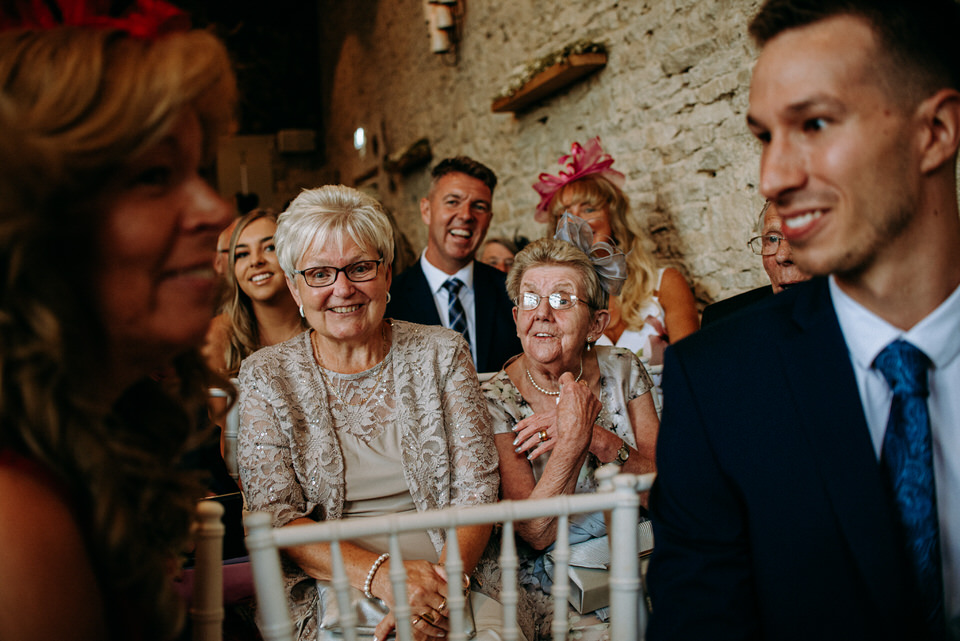 Ellie's Gran and Grnfdad laughing at the seremony at merriscourt barn