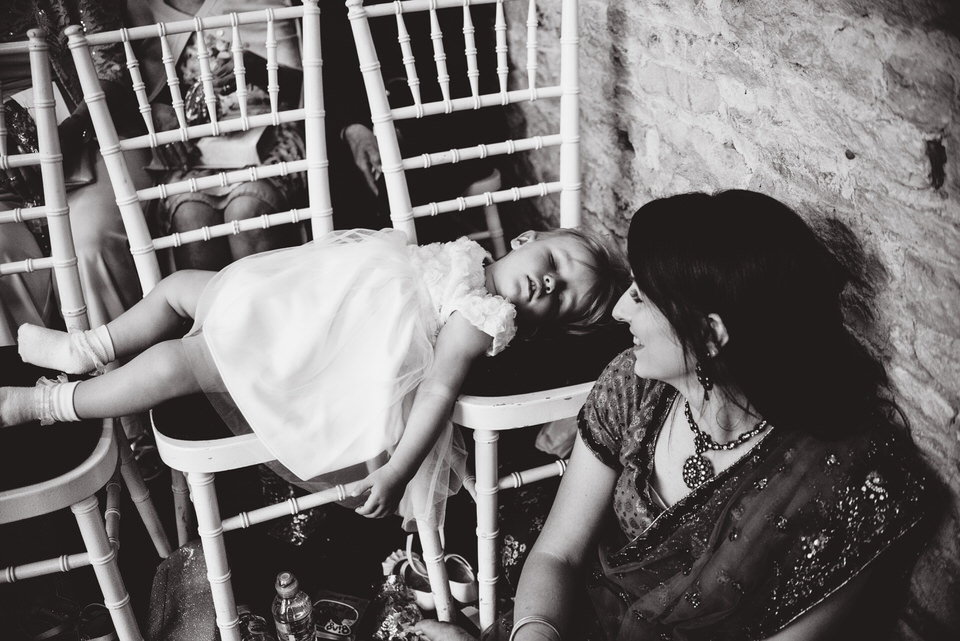 baby sleeping at the ceremony at Merriscourt Barn in the Cotswolds