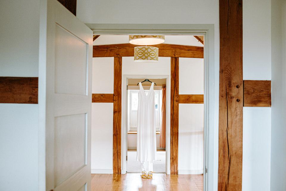 sarahs wedding dress hanging up