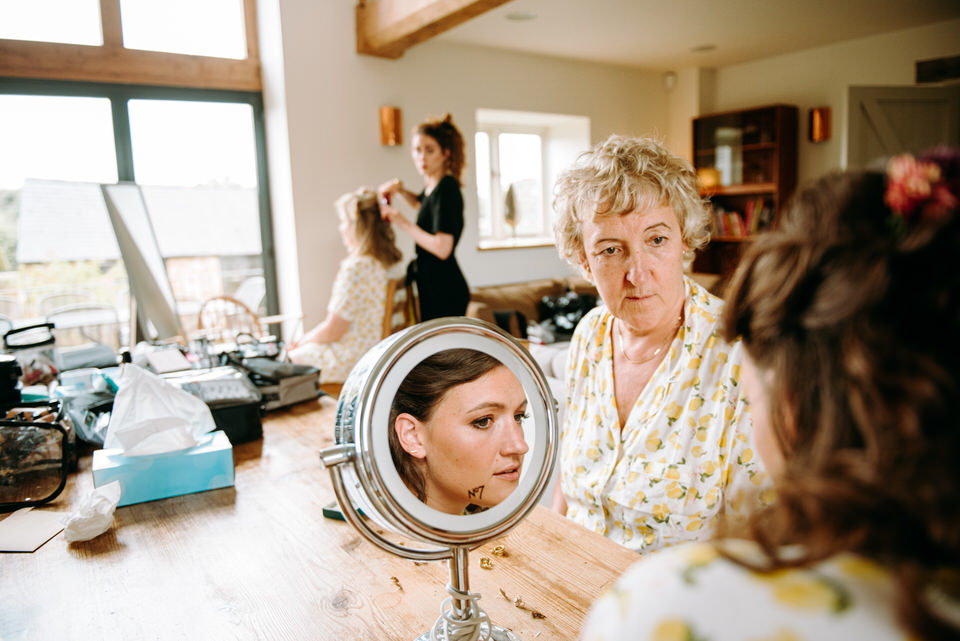 Sarah's mum and sister try on earings before the wedding at Longbourn Farm