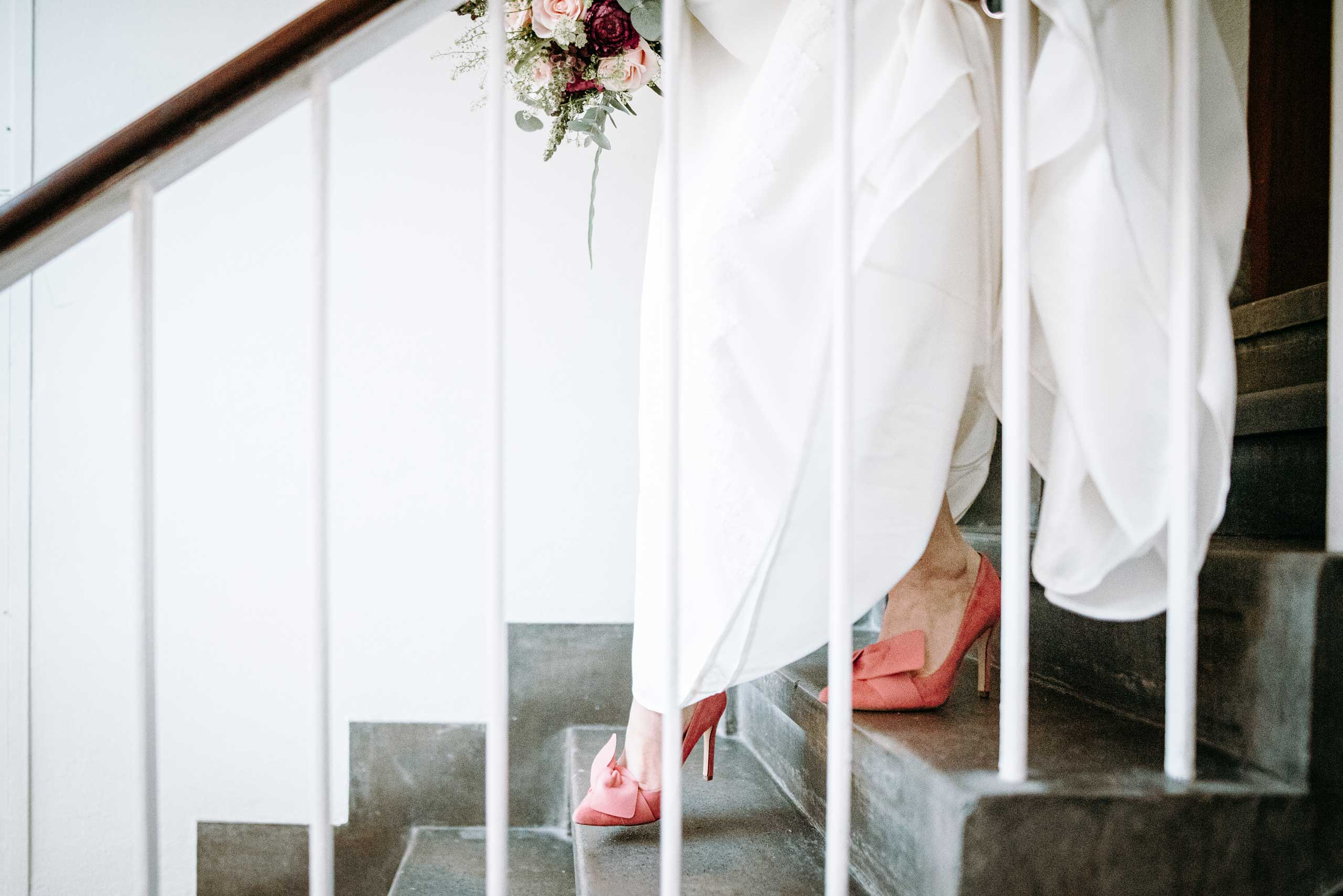 daisy walking down the stairs in her pink wedding shoes