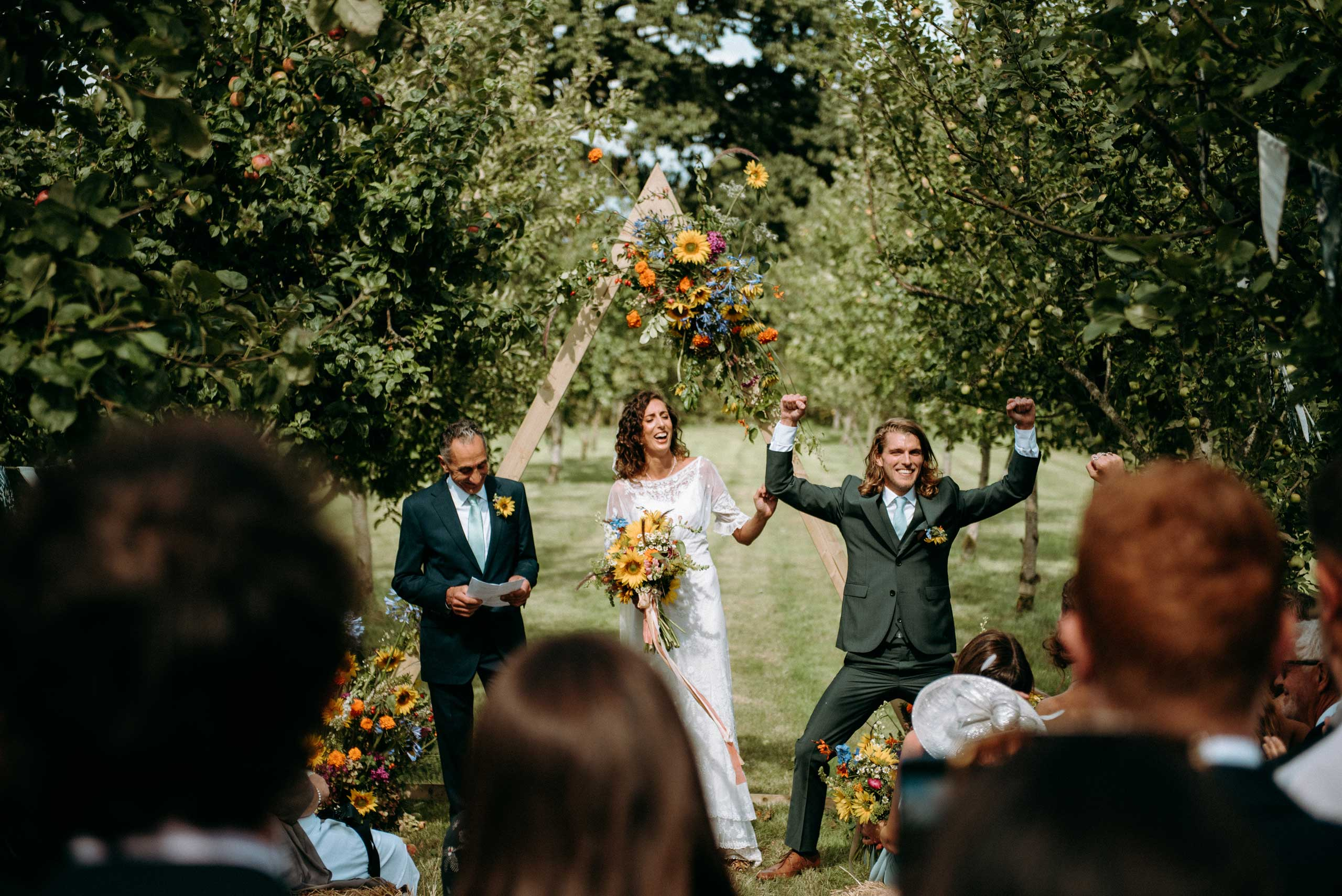 Amelia & Tom's ceremony at Stowford Farm witn the groom jumping for joy and fist pumping